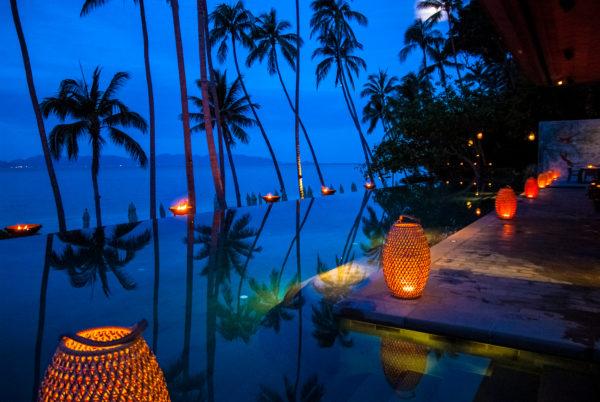 FSKS pool, twilight, palm trees, lanterns