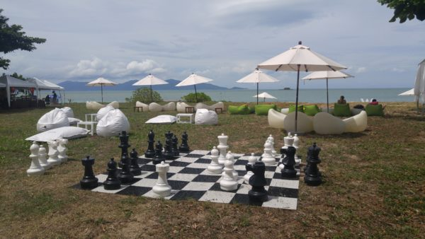 life size chess board, umbrellas, bean bags