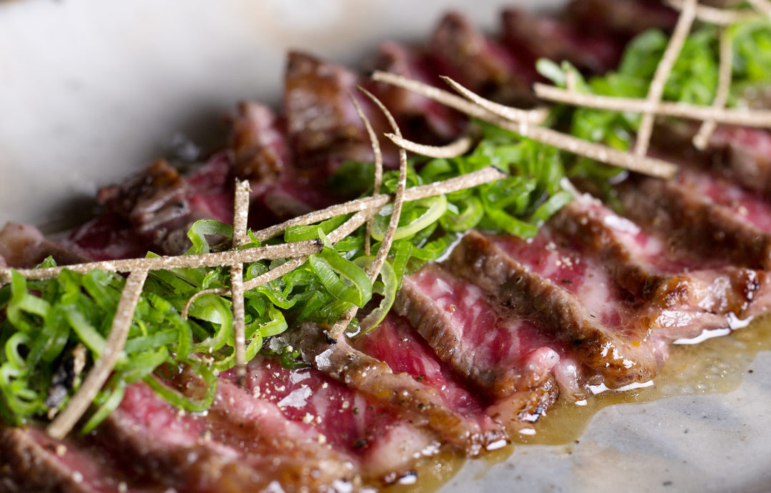 Wagyu beef, sauce, greens